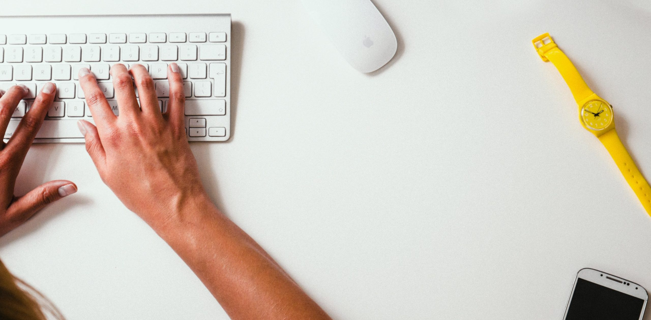 Image of person typing on keyboard